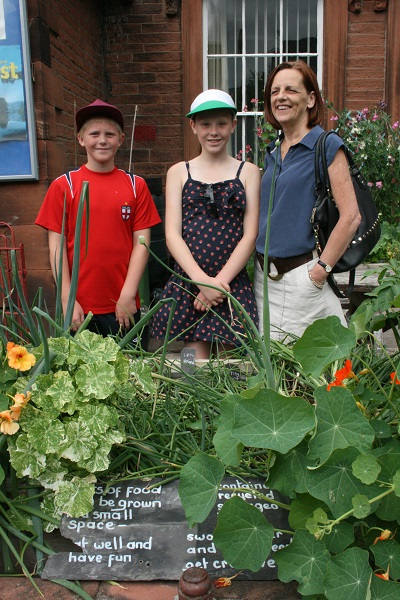 The McPhillips family, helpers at the raised beds at the Salvation Army in Penrith